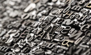 49101246 - letterpress background, close up of many old, random metal letters with copy space