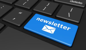 57627144 - newsletter concept with newsletter sign and email icon on a blue computer keyboard button 3d illustration.